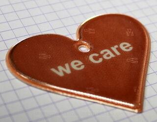 Sydän muotoinen pehmoheijastin we care