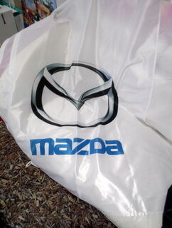 Mainoslippu Mazda